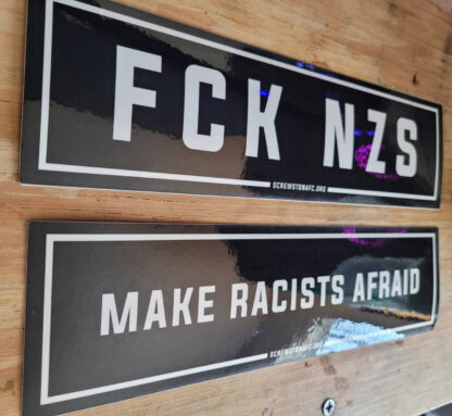 "Two bumper stickers which read ""FCK NZS"" and ""Make Racists Afraid"""